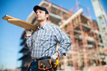 Carpenter at work in a construction site