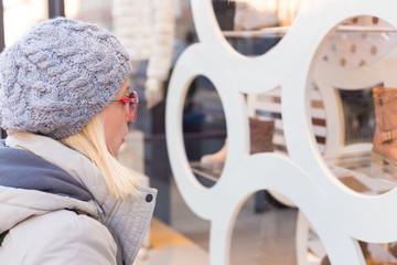 Woman window shopping.