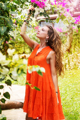 Pretty woman in park with flowers