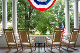 Four wooden rocking chairs and the American flag - 79972014