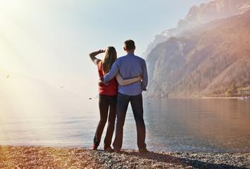 A couple at a mountain lake
