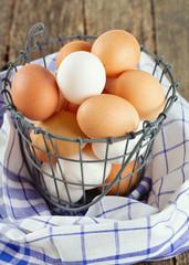 fresh farm eggs in iron basket