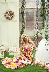 Beautiful blond woman in a dress of flowers