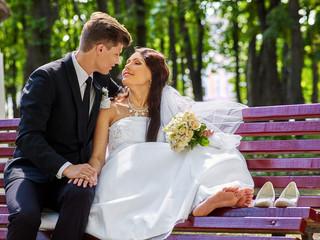 Groom embrace  bride  outdoor.