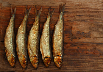 herring sprat fish smoked wooden table