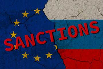 Cracked EU vs Russia flags. Ukrainian crisis conceptual image.