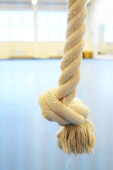 Closeup rope for climbing with knot in the gym