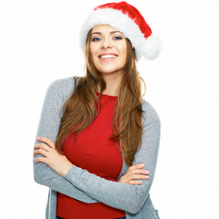 Santa girl with crossed arms standing against white background.