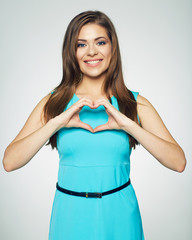 fashionable portrait of smiling woman showing heart made of fin
