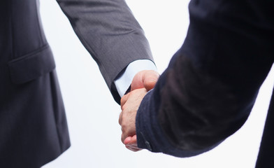 Closeup of a business handshake, on white background