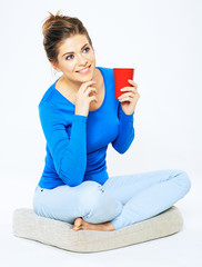 Young woman portrait with drink. Red coffee cup.