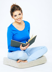 Girl student sitting with open book.