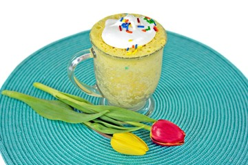 lemon cake in a mug with tulips