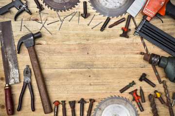 carpenter's wooden table with many types of tools