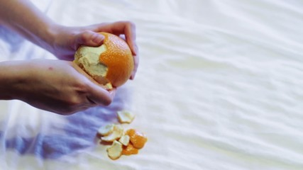 Man cleans orange. An accelerated