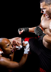 mma fighter performing a counter attack from a kick