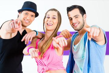 Group of men and women dancing zumba fitness