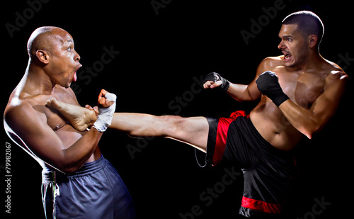 mma fighter performing a counter attack from a kick - 79982067