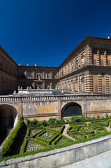 Facade of Pitti Palace with fountain and Boboli Gardens