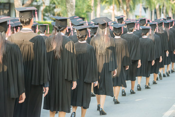 back of graduates during commencement.