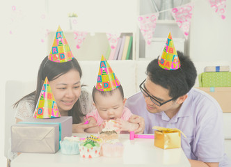asian parent with baby during birthday