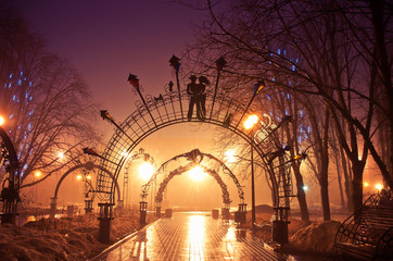 Beautiful forged figures park in the night