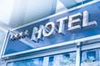 Leinwandbild Motiv Hotel - modernes Gebäude mit Schild
