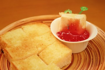 Bread, butter and strawberry jam in plate
