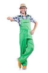 Young cheerful gardener in hat and green uniform isolated on