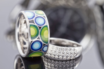 silver ring with precious stones and ring with colored enamel