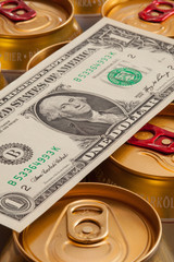 Cans of beer and US dollar