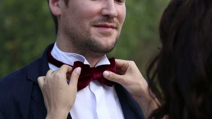 groom wears a bow tie