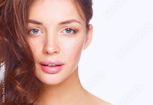 Close up portrait of beautiful young woman face. Isolated on - 79994812