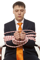 Businessman tied up