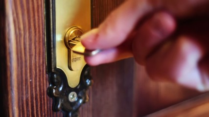 The man opens the door using the key