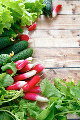 fresh radishes and other vegetables on wooden boards