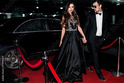 Leinwanddruck Bild Sexy couple in the car. Hollywood star.