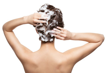 Woman soaping the hair. Beauty treatment