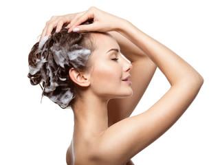 Beautiful woman soaping the brown hair