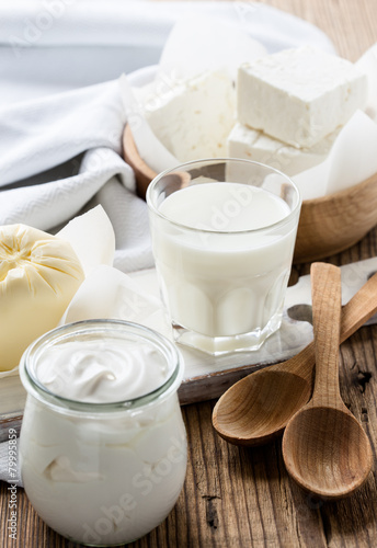 Leinwanddruck Bild Dairy products on wooden table