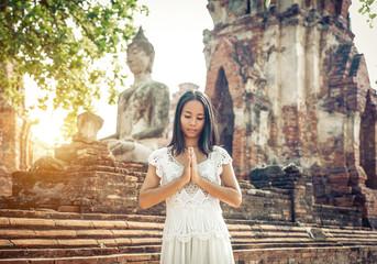 thai woman praying in ayutthaya