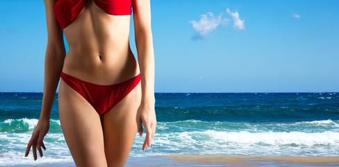 Slim sexy woman on the beach