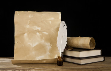 old paper, books and feather