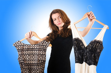 Young woman trying new clothing on white