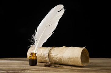 old paper and feather