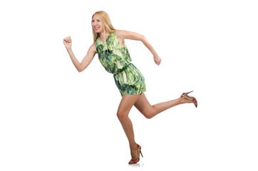 Woman in fashionable green mini dress isolated on white