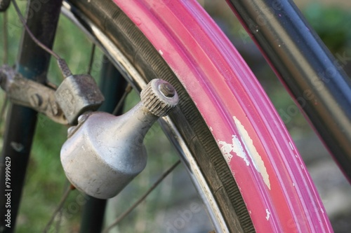 Foto op Aluminium Fiets Old and rusty bottle or sidewall dynamo on bicycle