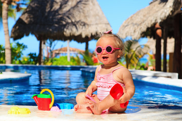 cute toddler girl playing at tropical beach