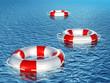 Three lifebuoys, floating on waves