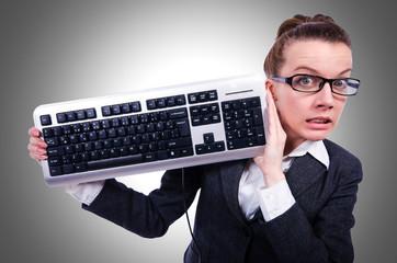 Nerd businessman with computer keyboard on white